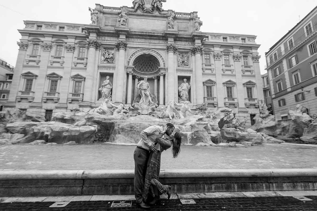 Black and white image. Honeymoon photo shoot at the Trevi fountain in Rome Italy.