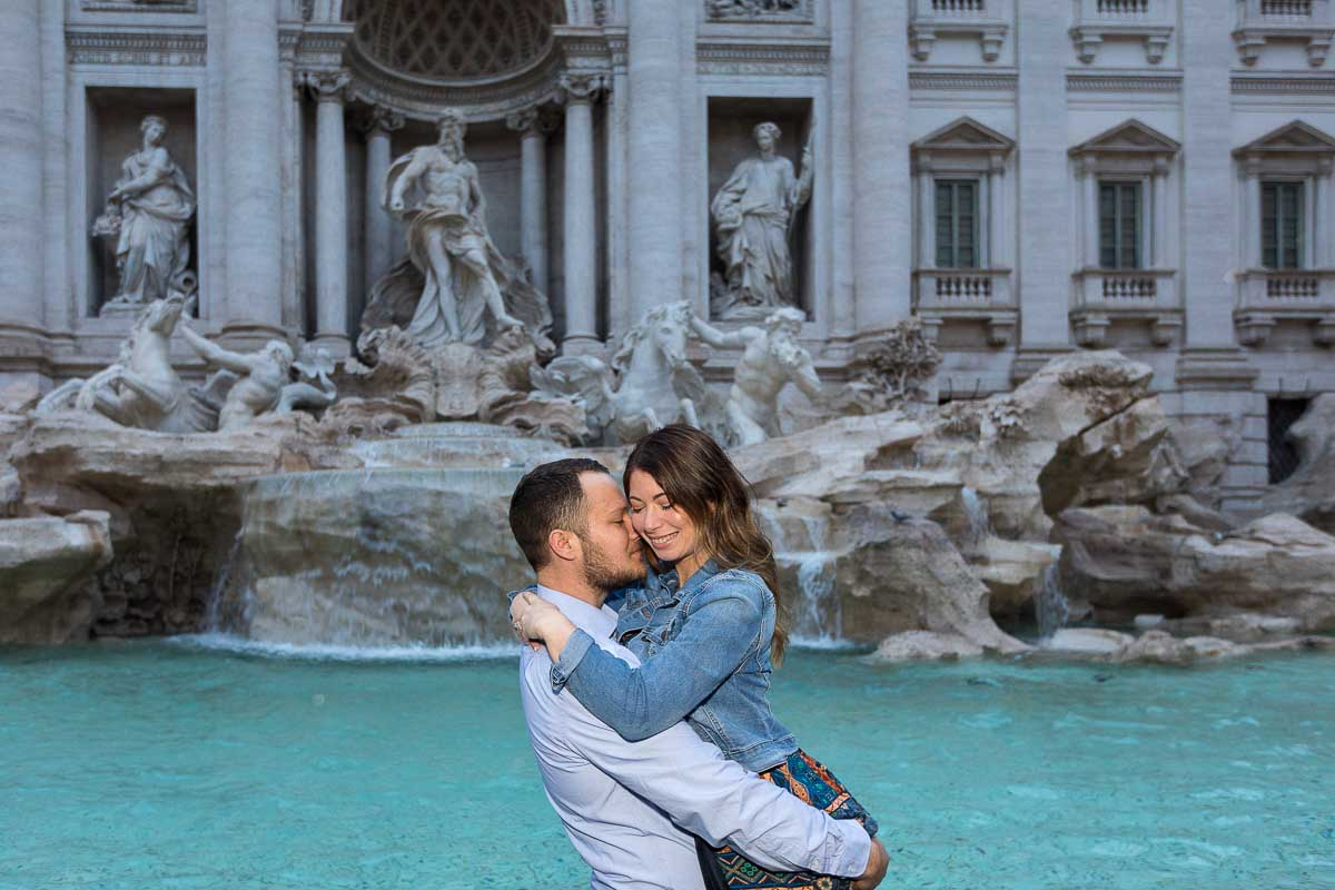Closed in portrait of a couple in love photographed at the Trevi fountain suring a photo shoot