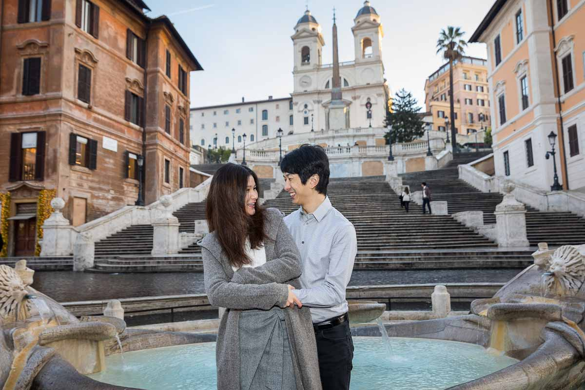Couple posed portrait during a photo session in Rome at the Spanish steps