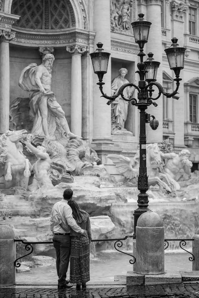 B&w image while admiring the beauty of the fountain. Rome, Italy.
