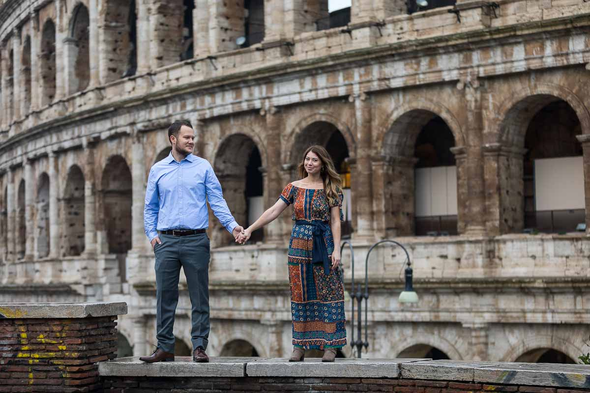 Holding hands in front of the Roman Colosseum