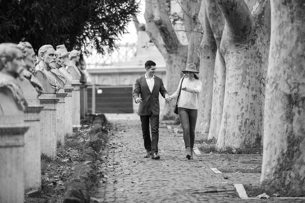 Walking hand in hand in the roman street and alleyways. Black and white photography