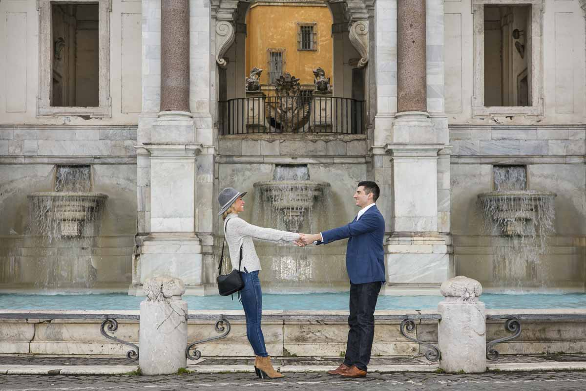 Posing holding hands in front of the Fontanone water fountain