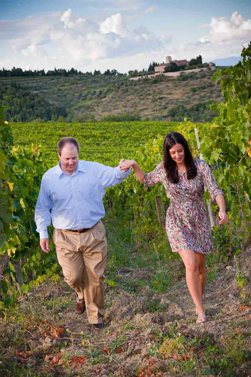 Couple walking hand in hand in a vineyard Tuscany Italy during a Florence Photographer session