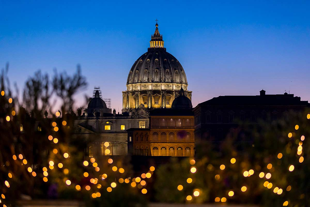 View of Saint Peter's dome at dusk with Christmas lights