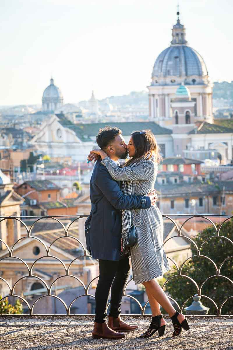 Kissing during a couple photoshoot in the ancient city of Rome