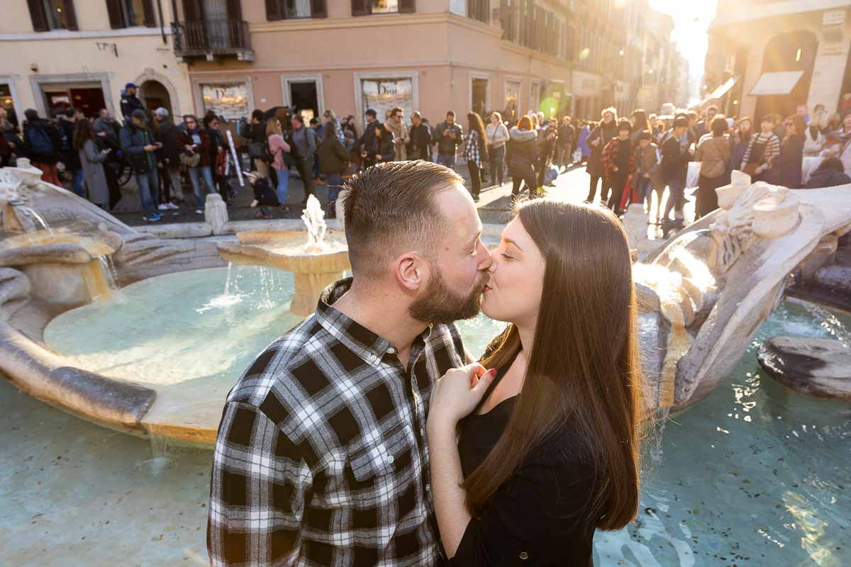 Kissing by the Barcaccia water fountain with sunsetting light