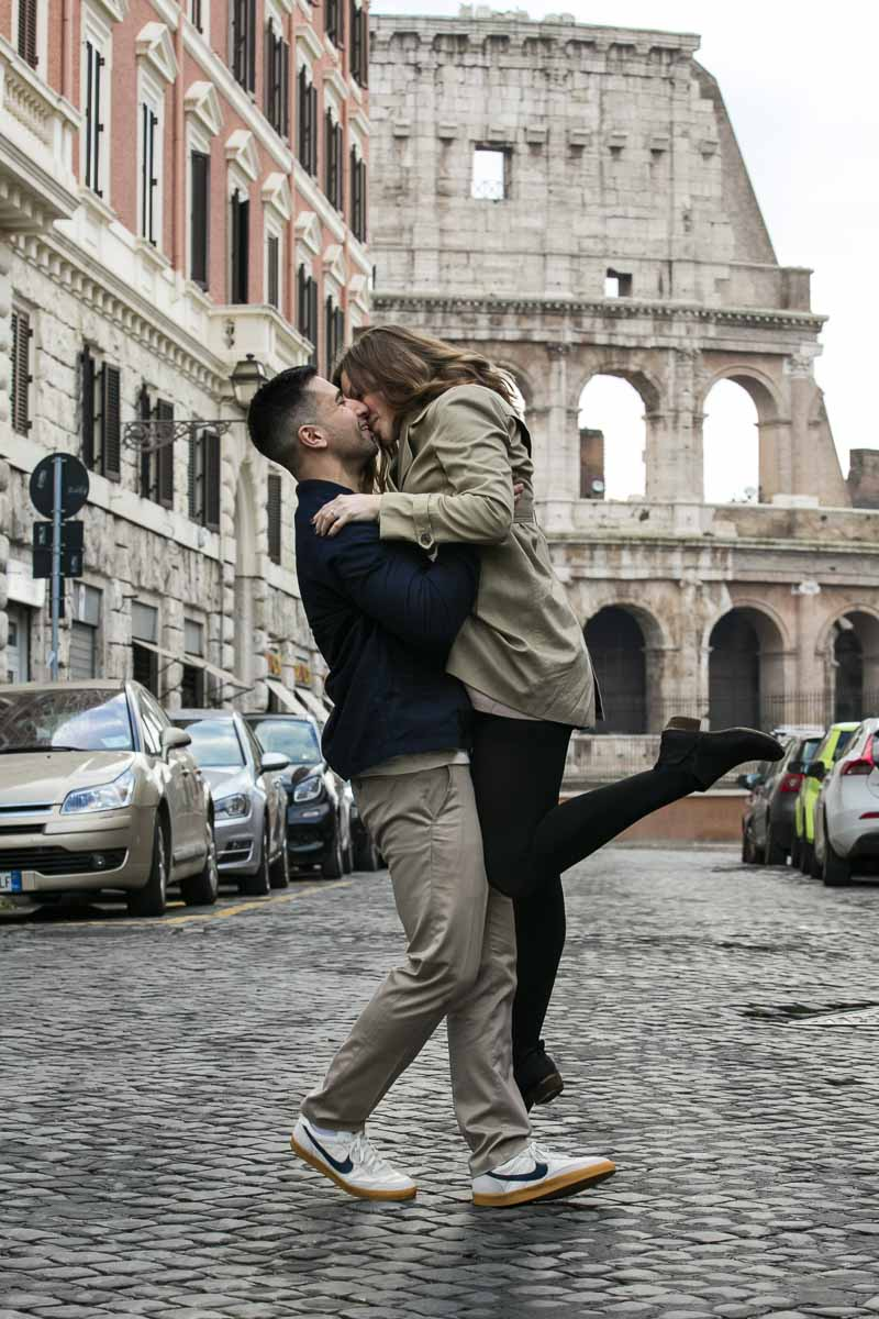 Color image version of a couple kissing in Rome during an engagement photo shoot