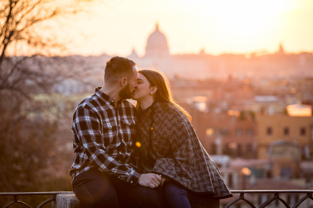 In love in Rome photoshoot. Couple kissing at sunset