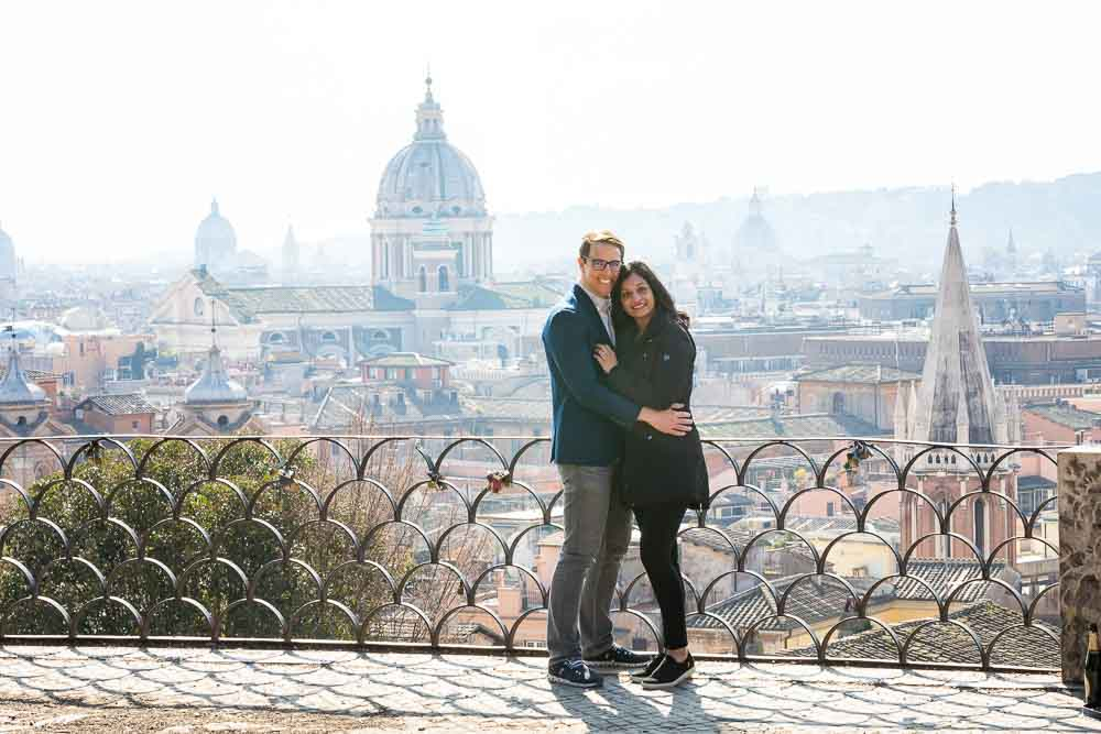 Taking a portrait picture engagement session with the beautiful roman city in the background