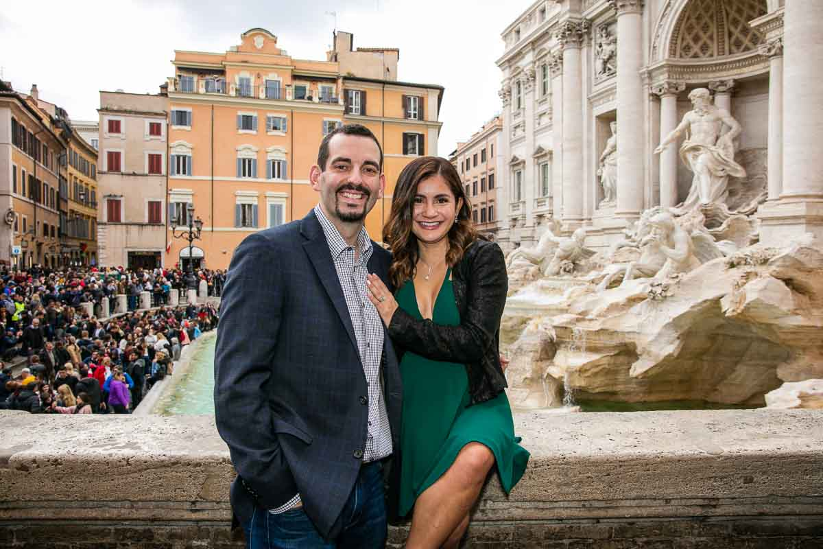 Posed couple portrait taken in front of the Trevi fountain from a high point
