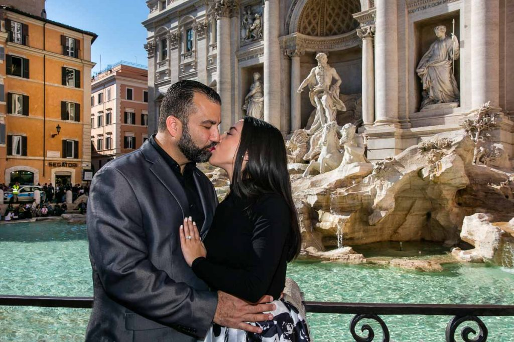 Couple kissing during an Engagement photoshoot at the Trevi fountain in Rome Italy by the Andrea Matone photographer studio