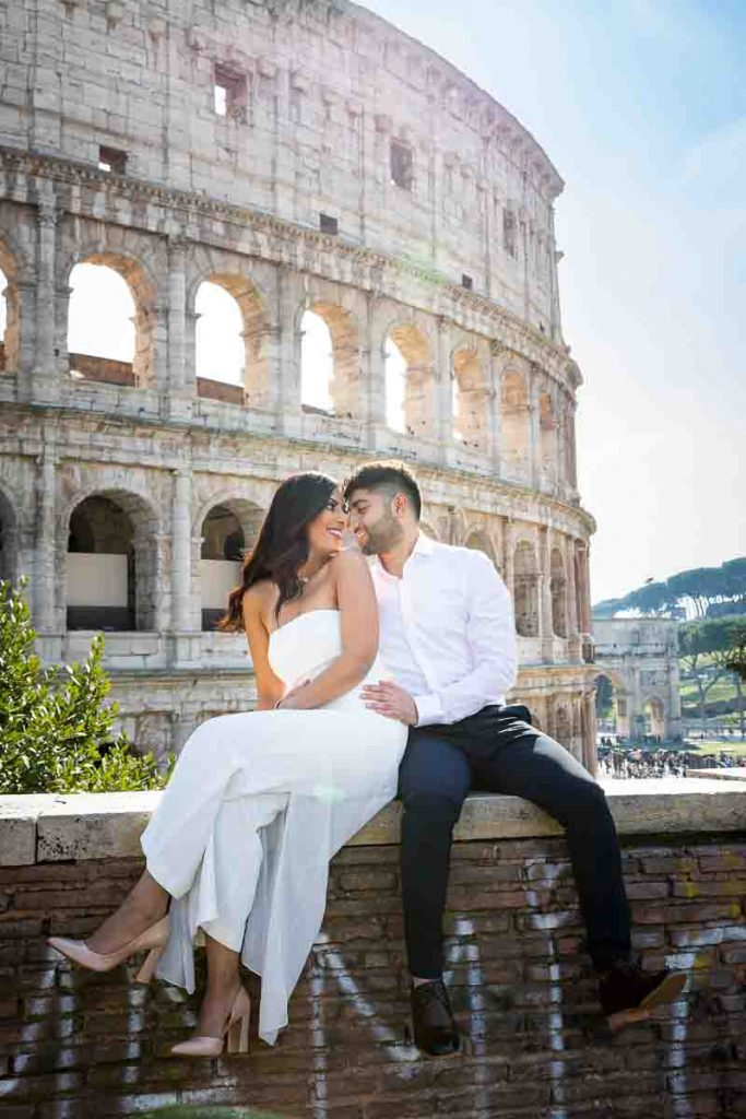 Newlywed couple having fun at the Roman Colosseum in Rome Italy