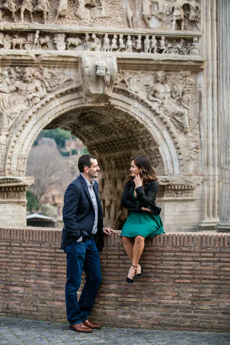 Posed picture portrait engagement underneath the arch of septimius