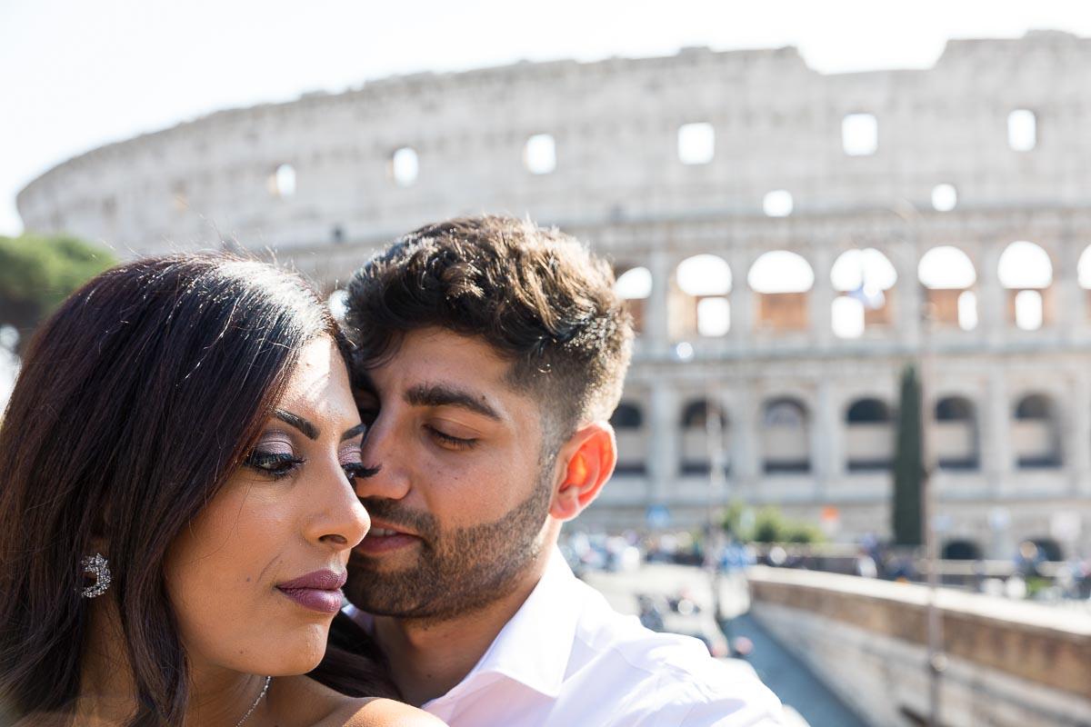 Close up couple portrait before the roman coliseum