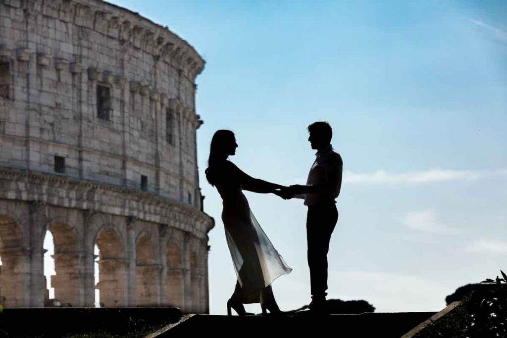 Silhouette image of bride and groom posing in front of the Colosseum