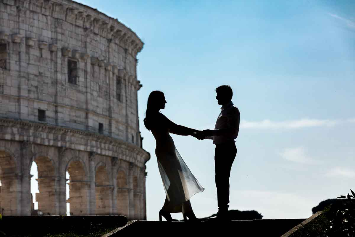 Silhouette image of bride and groom posing in front of the Colosseum. Rome Pre Wedding Photography.