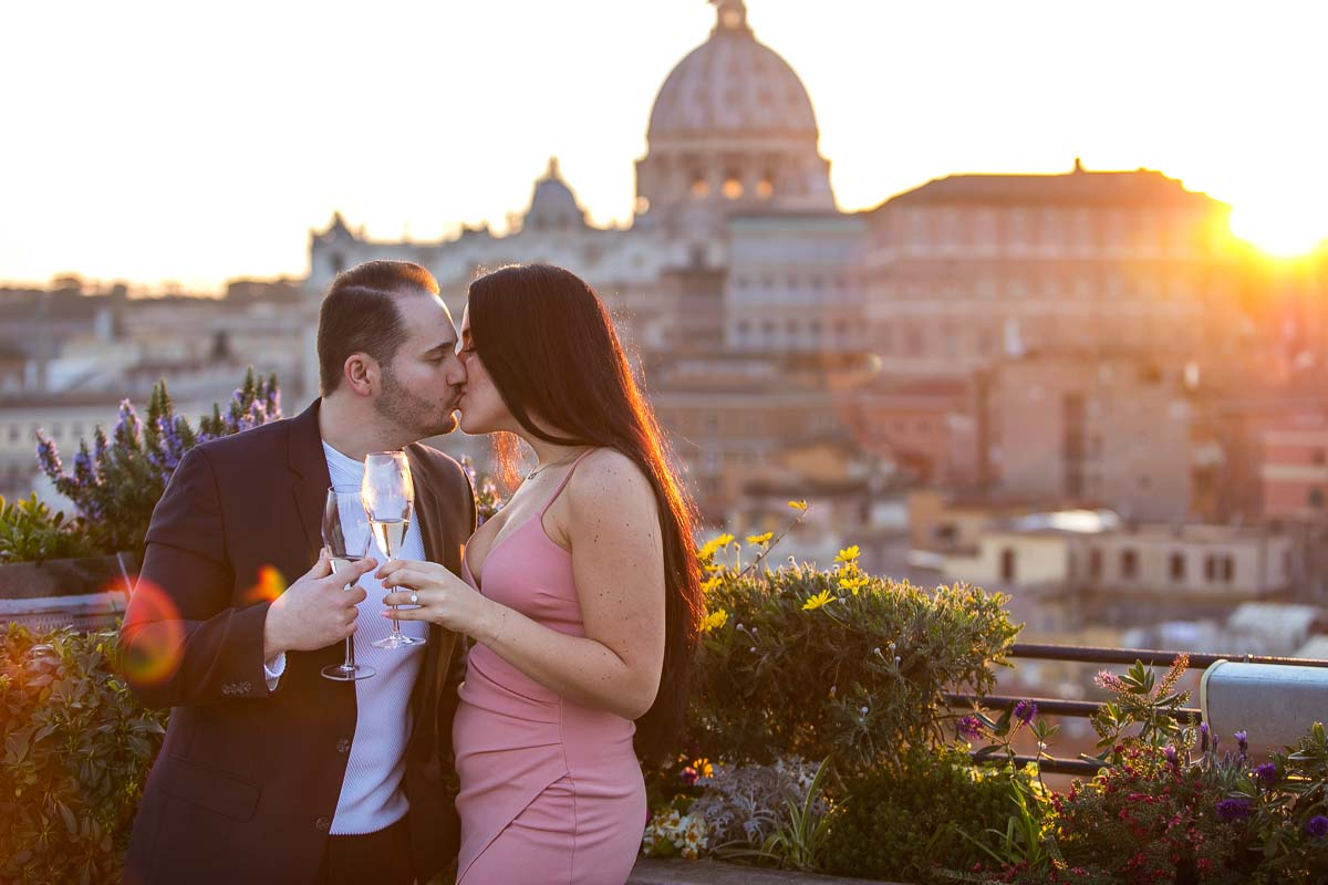 Just engaged. Celebrating engagement during a unique and creative photo session overlooking the roman skyline at sunset