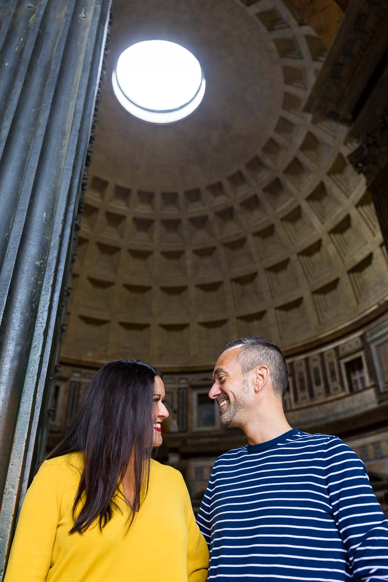 Couple portrait picture taken underneath the roman pantheon oculus found at the entrance