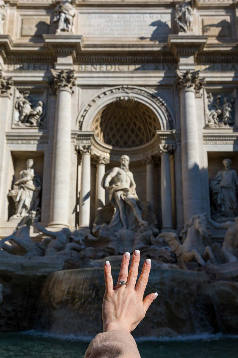 The engagement ring against the statues of the Trevi fountain