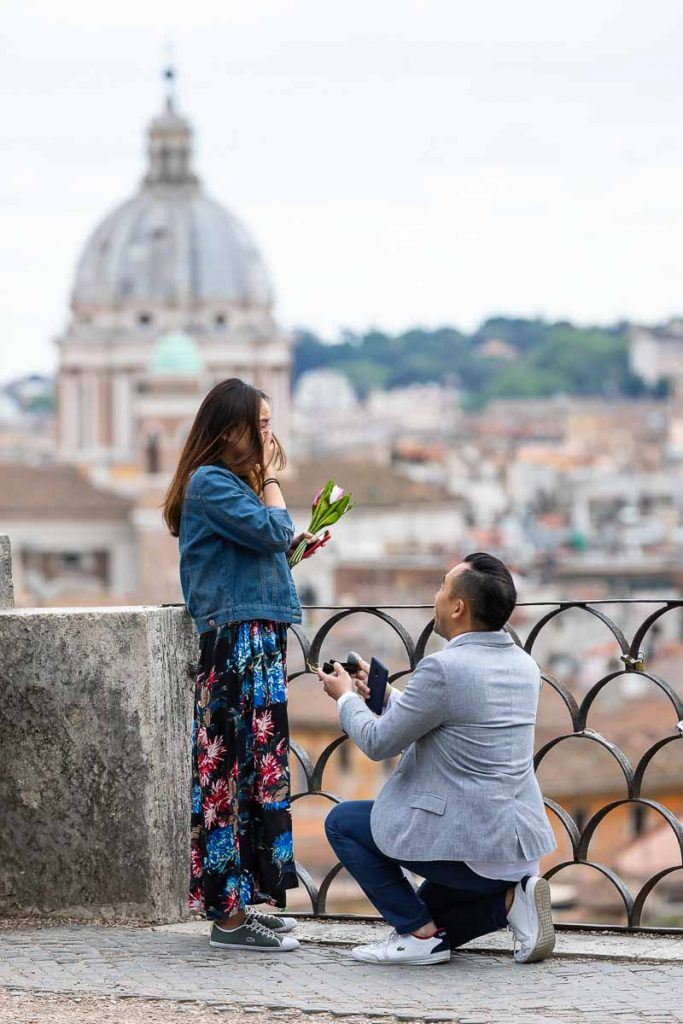 Surprise wedding proposal taking place at the scenic terrace view of Parco del Pincio in the Villa Borghese gardens of Rome Italy