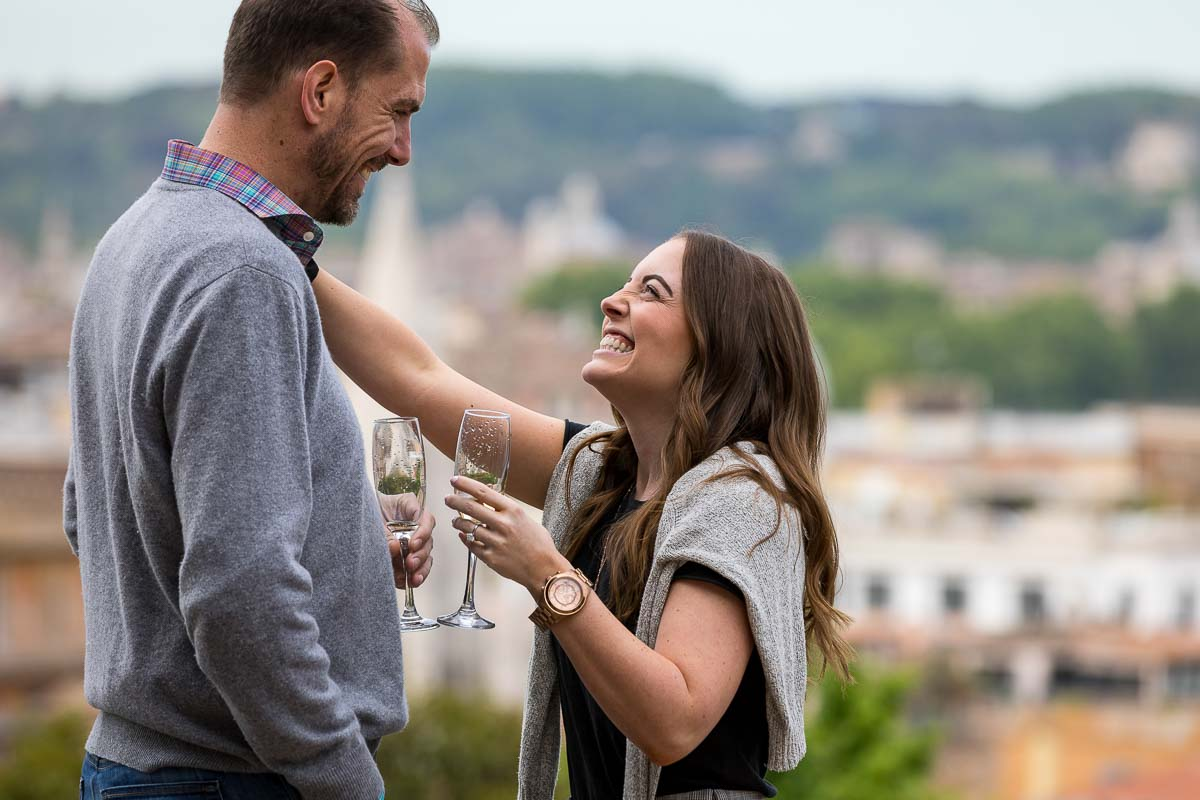 Couple celebrating holding glass flutes with Italian prosecco dry sparkling wine