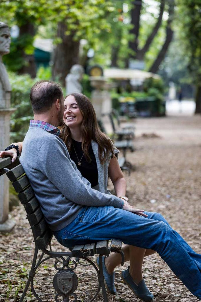 Sitting down portrait laughing and talking together on a park bench