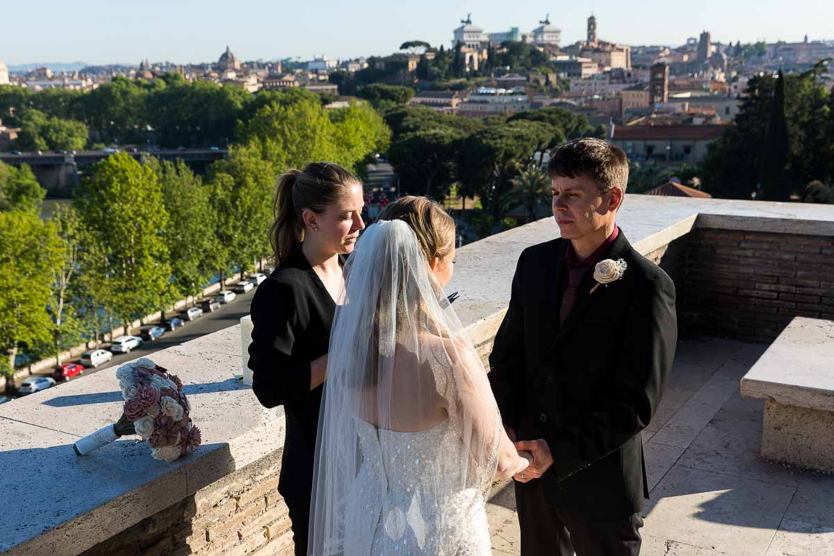 Getting married on the terrace of Giardino degli Aranci in Rome Italy with the city in the background