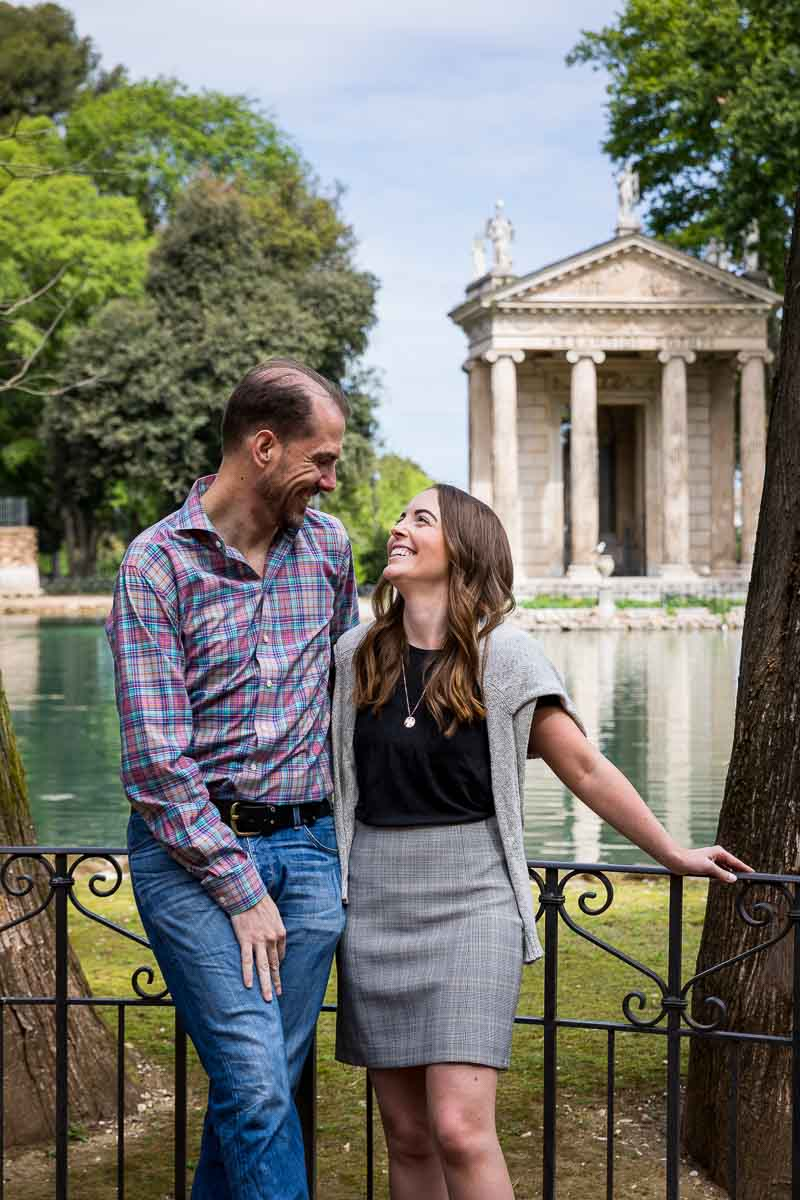 Engagement portrait picture with Villa Borghese's lake and temple in the background