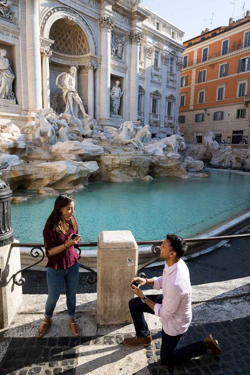 Surprise engagement proposal at the Trevi fountain in Rome Italy
