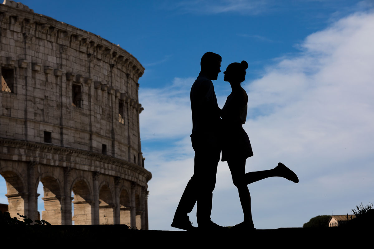 Silhouette picture portrait at the Roman Colosseum. Engagement in Rome Italy