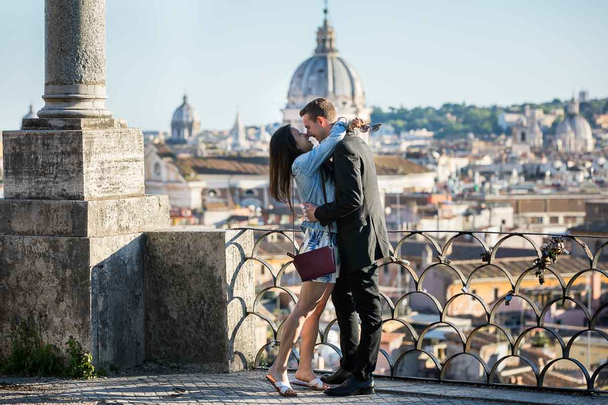 Horizontal photo view embracing couple overlooking the roman skyline in color photography