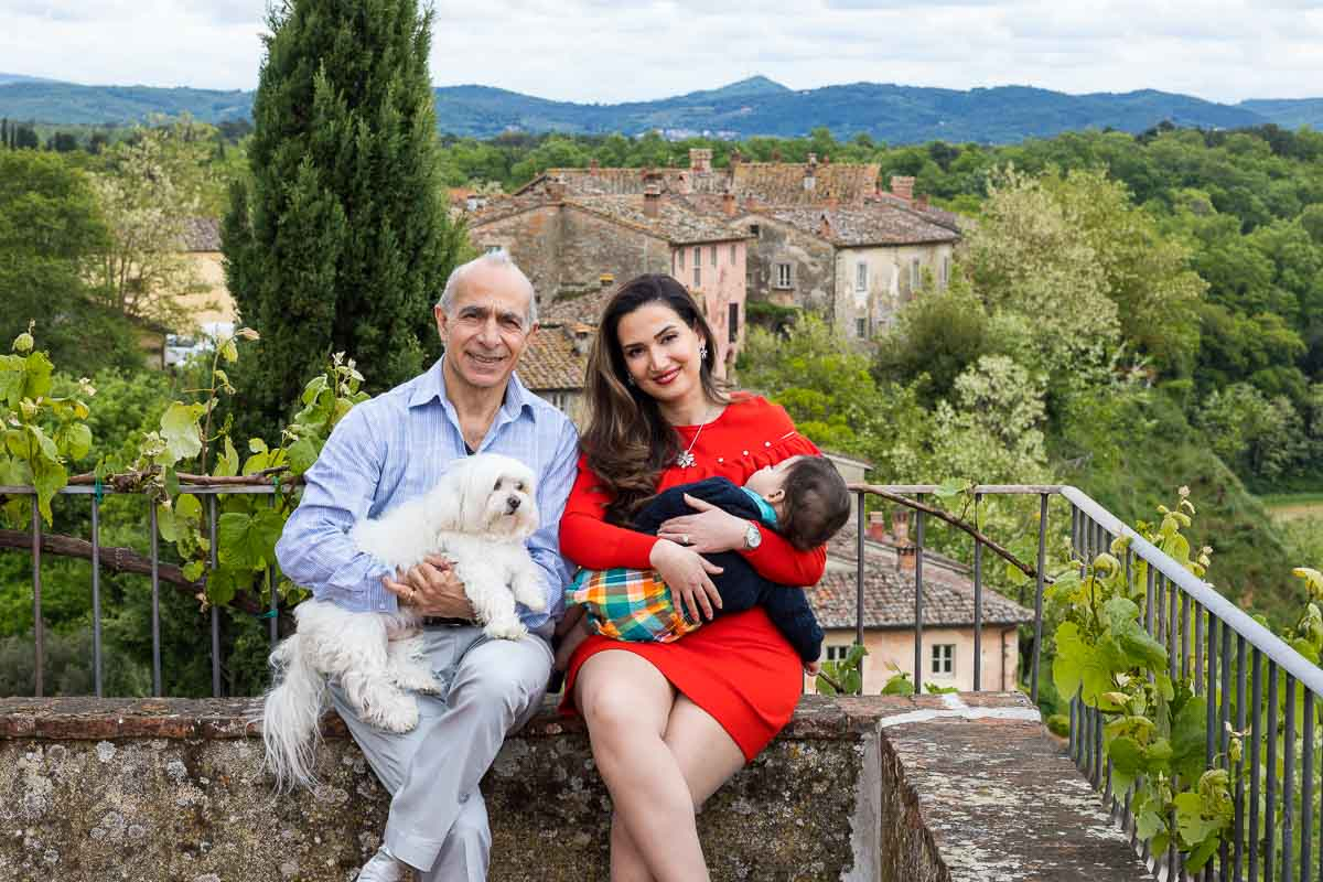 Portrait picture of a family before the Tuscany borgo town in Italy