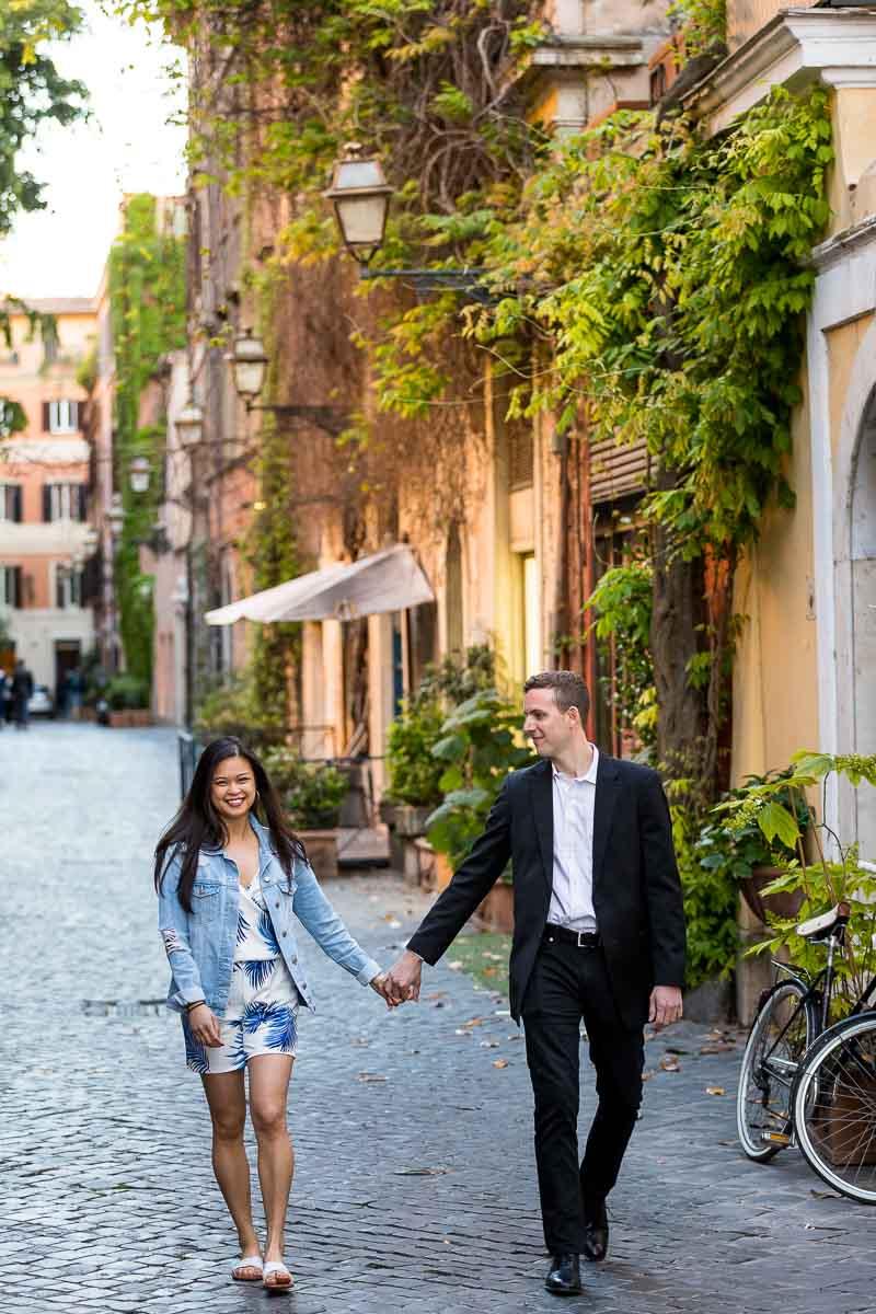 A nice walk on in Rome's via Marghutta cobblestone roman alleyways