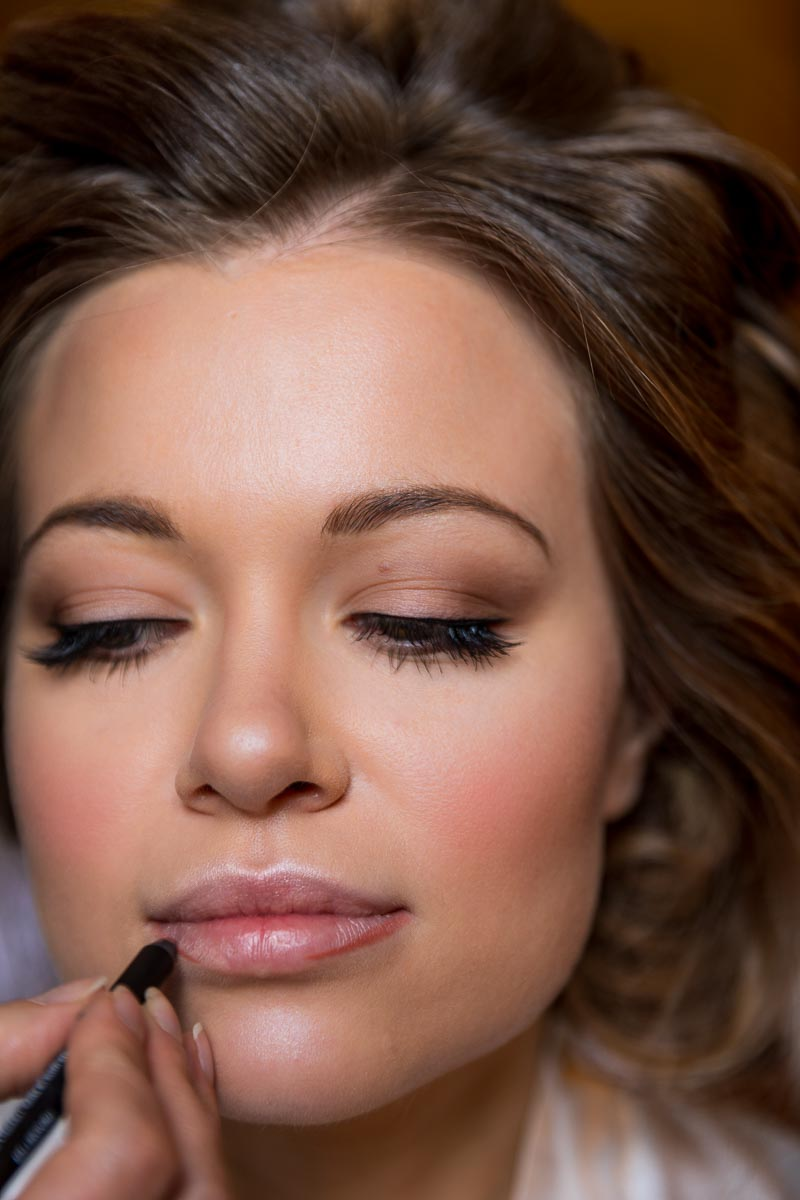 Beauty image. Bride facial close up during the hair makeup session wedding preparation