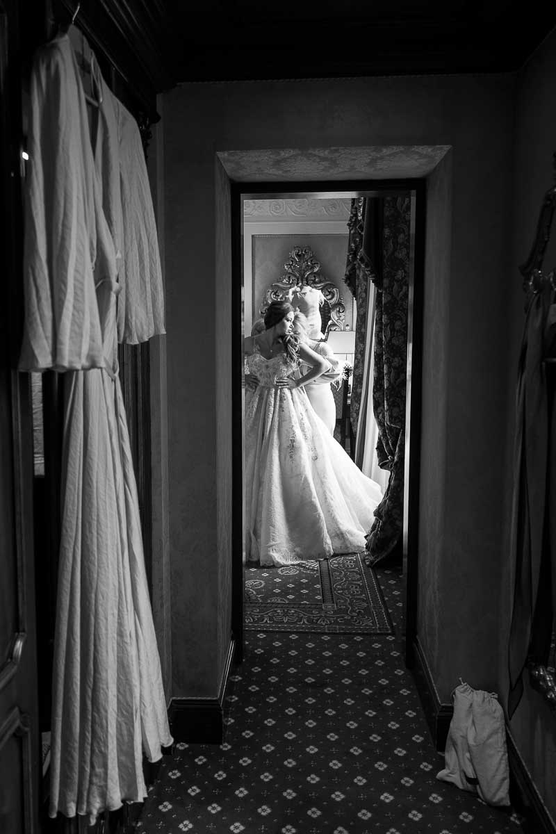 Putting on the wedding dress. b&w image photography
