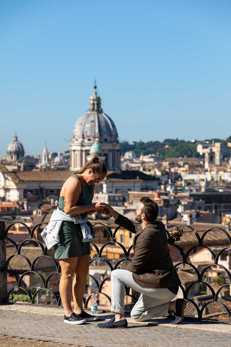 Proposing in Rome. Man down on one knee asking his fiancee in marriage