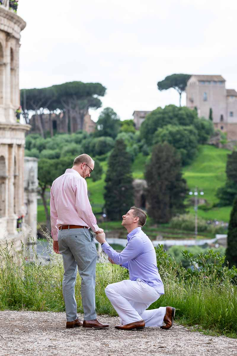 Same sex wedding marriage proposal taking place near the Colosseum in Rome. LGBT Friendly Wedding Proposal