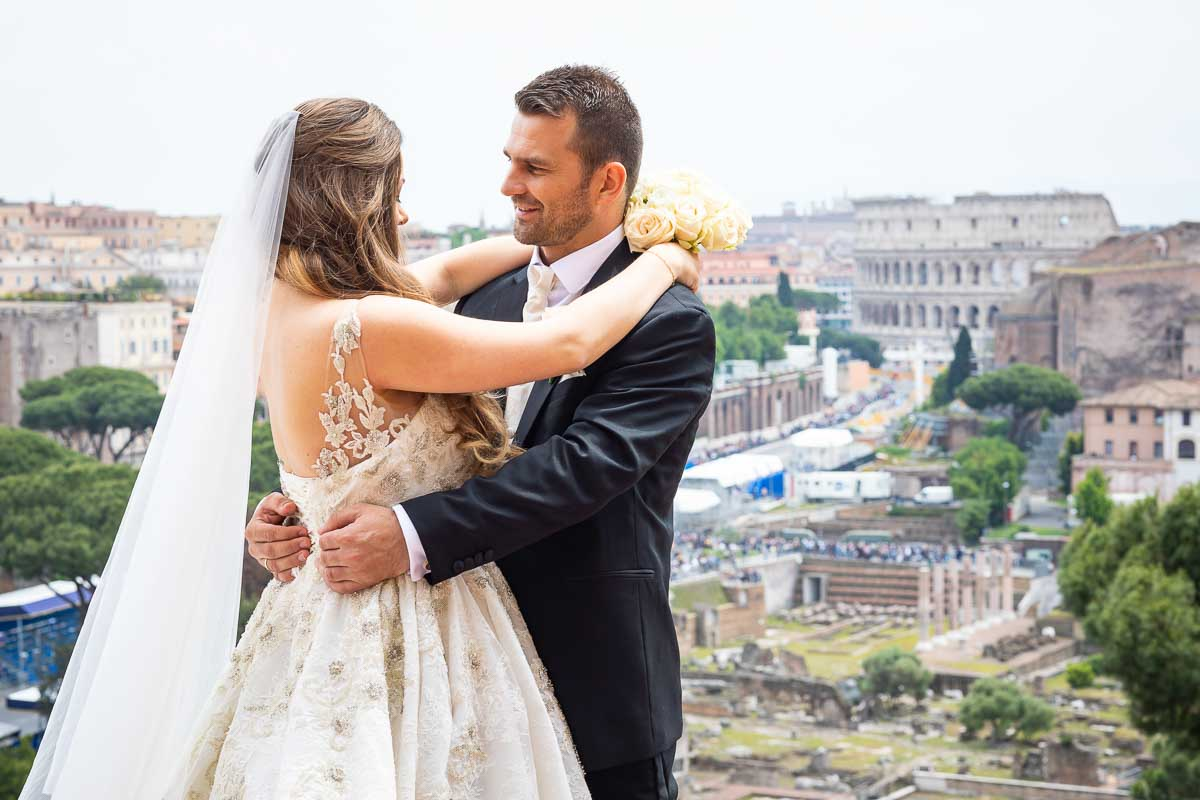 Newlyweds portrait overlooking the city of Rome in the distance