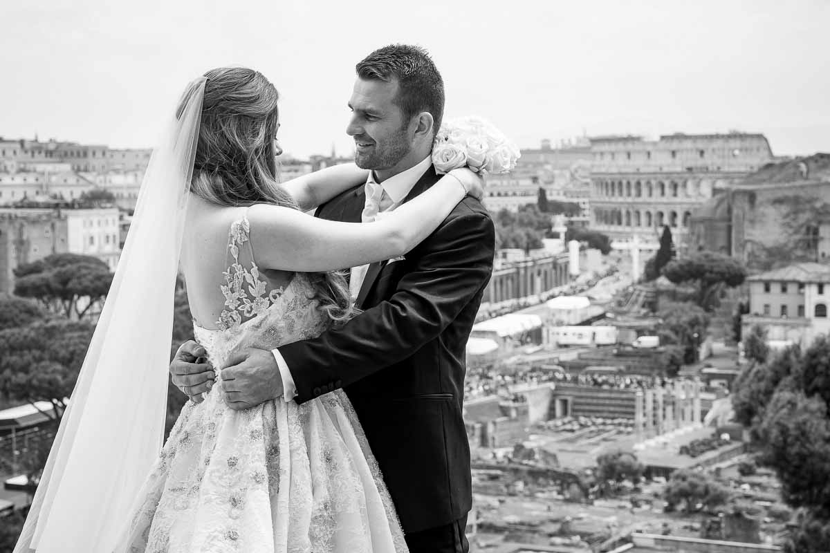 Black n white image conversion as newlyweds stand before the roman skyline in the far distance