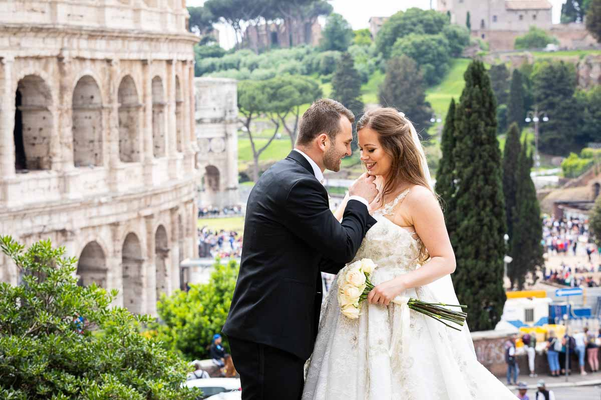 Groom and bride photo session at the Roman Colosseum in Rome Italy