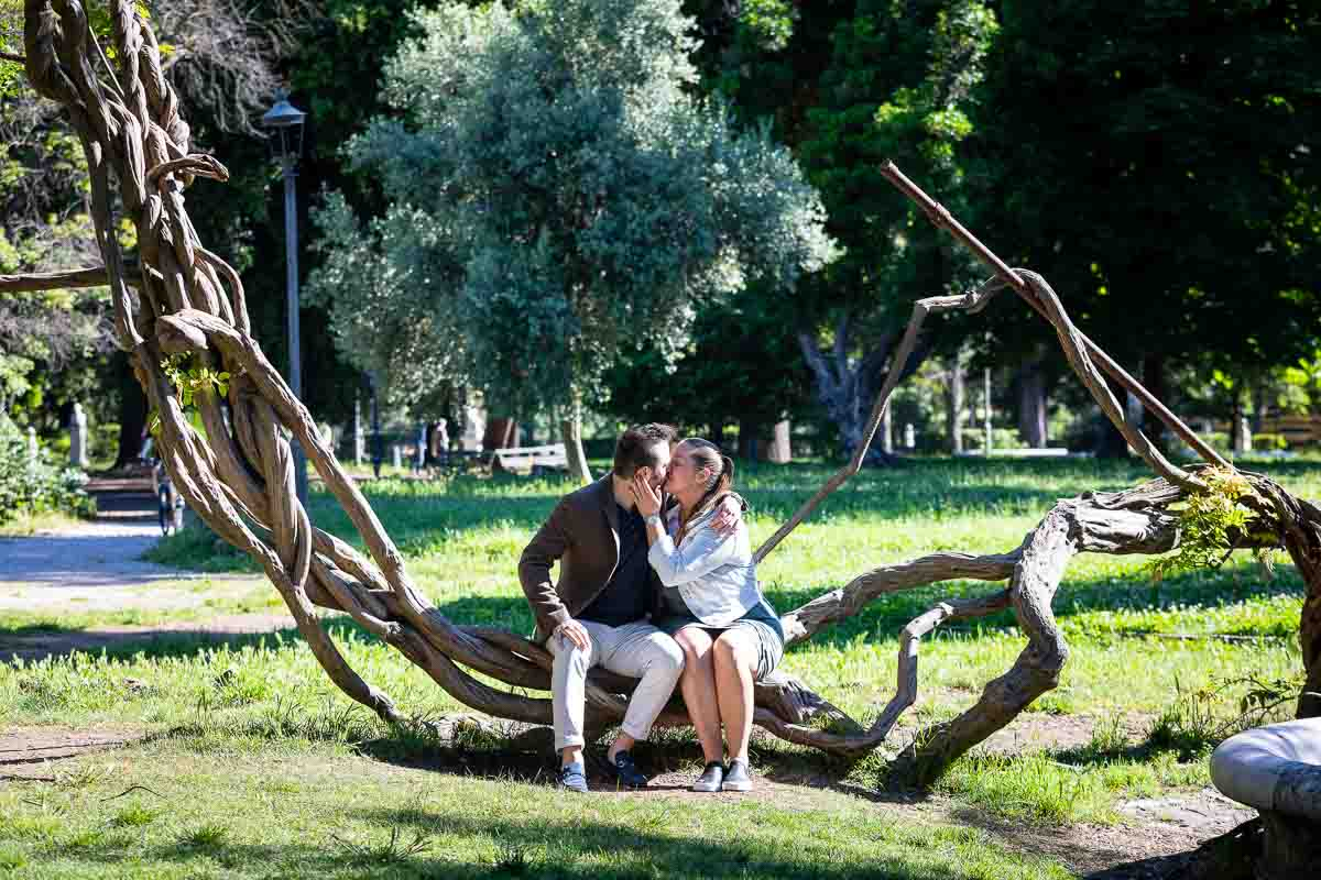 Couple kissing in love in Villa Borghese park