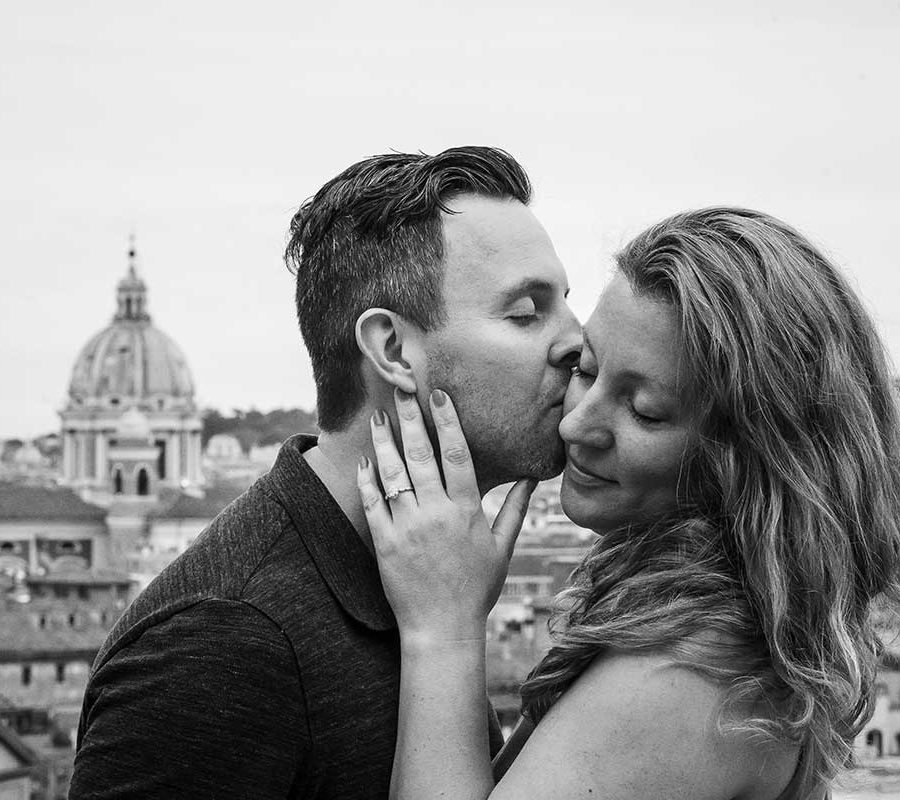 Couple portrait image in black and white with the ancient city of Rome in the background