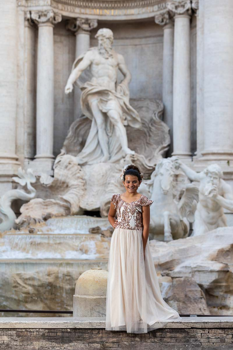 Girl portrait taken at the Trevi fountain in Rome Italy
