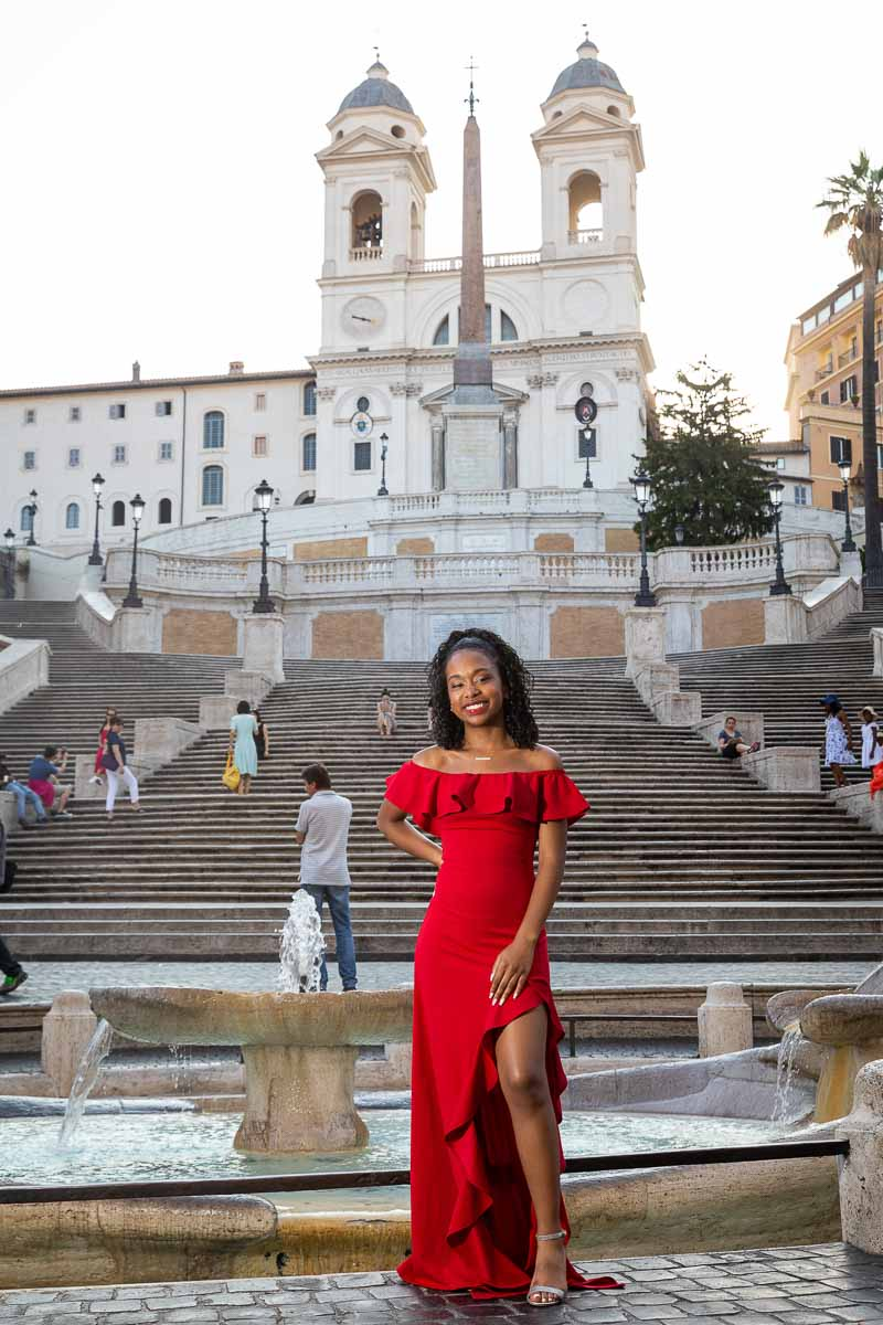 Girl wearing a red dress in front of Piazza di Spagna