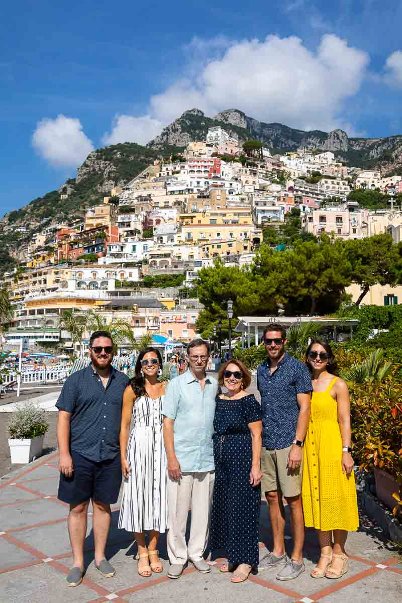 Positano family portrait picture in front of hill town