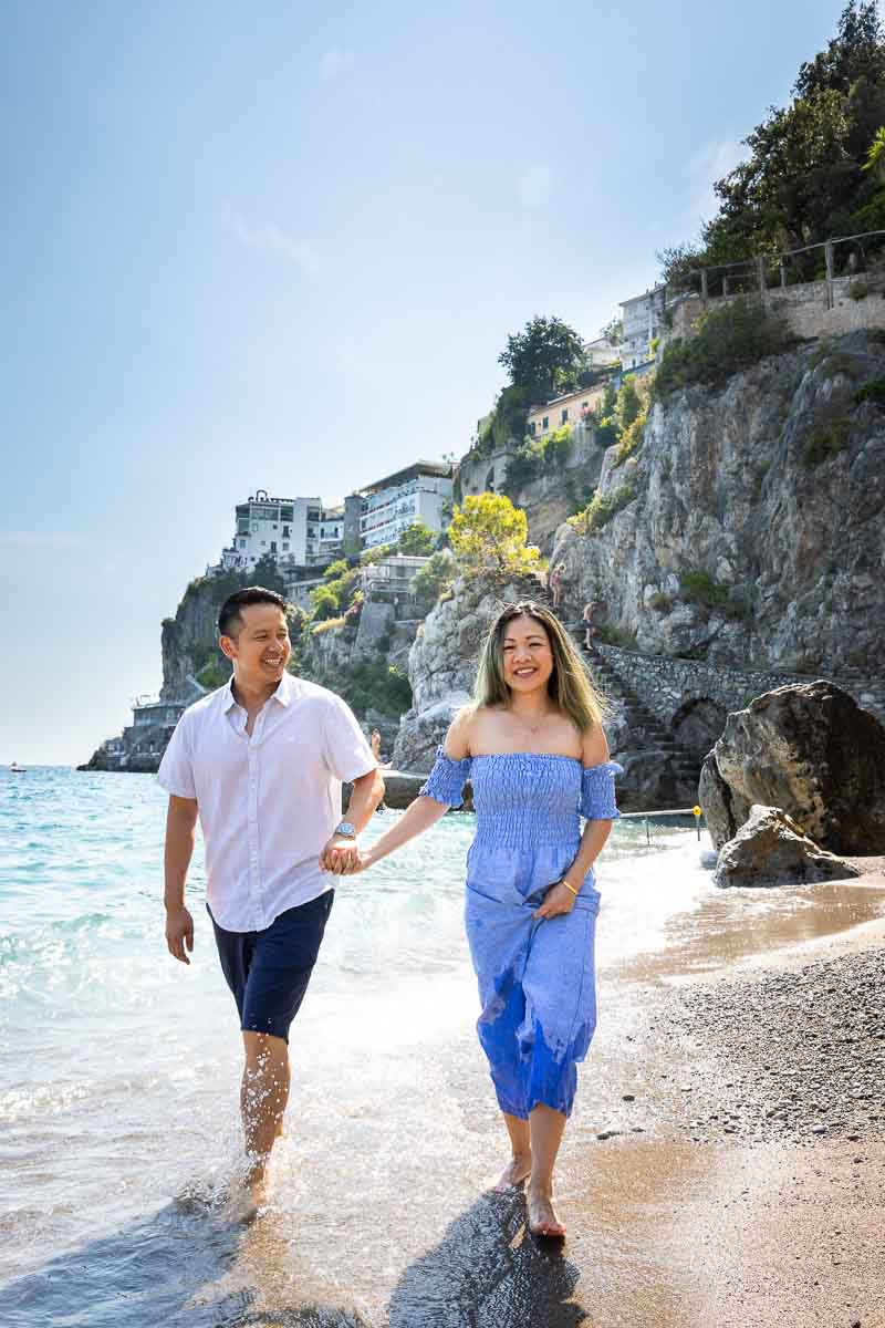 Couple walking on the beautiful beaches of the Amalfi coast during a photography session