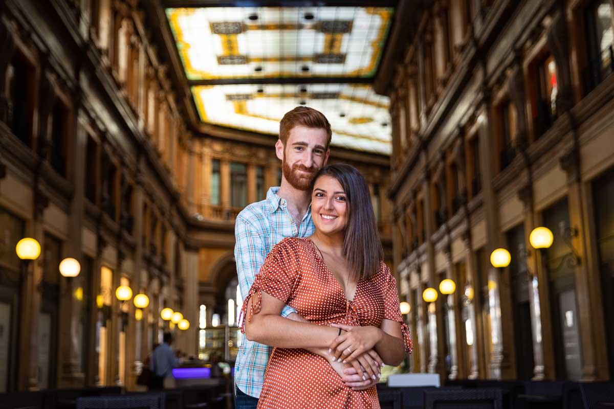 Closeup couple portrait standing inside Galleria Colonna