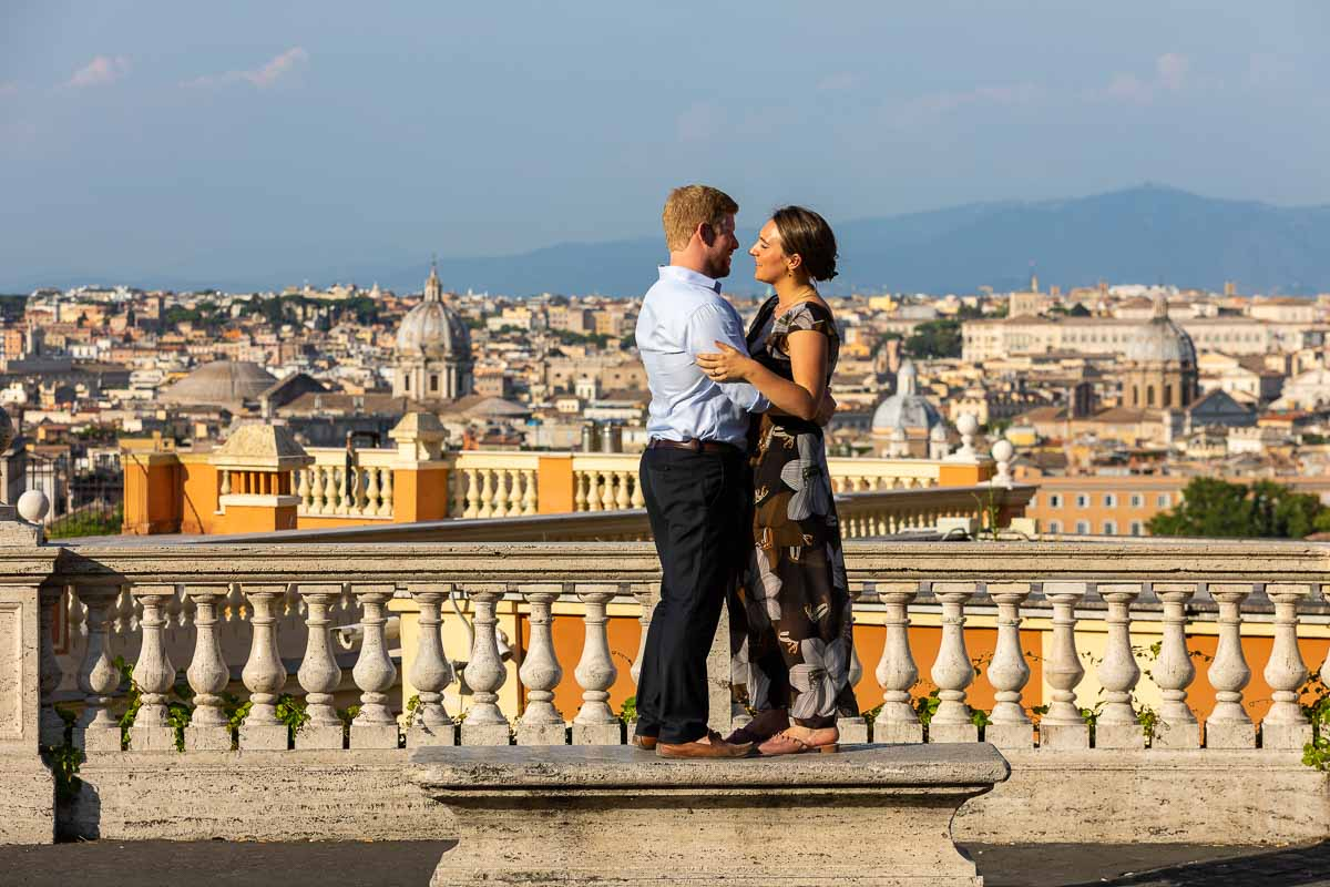 Standing on a marble bench before the beautiful roman scenery view
