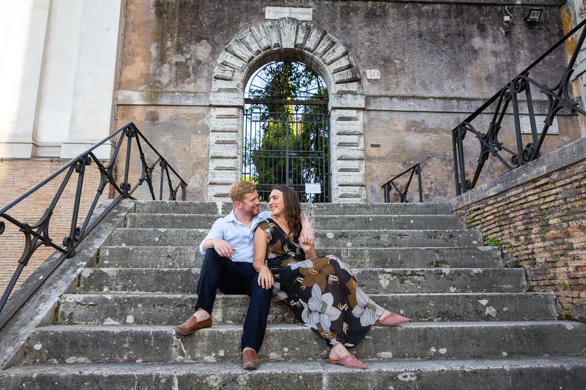 Posed couple sitting down on side steps